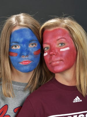 University of Mississippi freshman Claire Parrish (left) and her mother, Kim Parrish, a Mississippi State University grad student, are proud of their respective schools.
