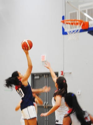 Destiny Castro goes for an easy layup during Guam's women's national basketball team practice on June 14, 2018 at the Guam Basketball National Training Center in Tiyan. Both she and Team Guam teammate Kali Benavente also start for the Chaminade Lady Silverswords of Hawaii.