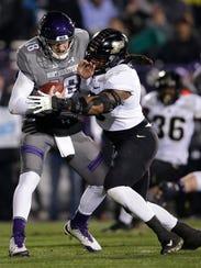 Purdue linebacker T.J. McCollum, right, sacks Northwestern quarterback Clayton Thorson during the first half of an NCAA college football game Saturday, Nov. 11, 2017, in Evanston, Ill. (AP Photo/Nam Y. Huh)
