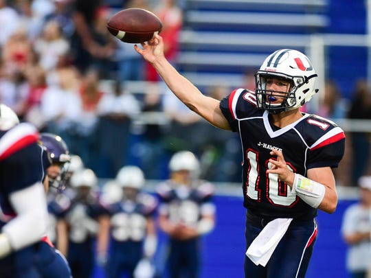 Urbandale quarterback George Reis (10) makes a pass Friday, Sept. 9, 2016, during a football game between the Urbandale J-Hawks and the Johnston Dragoons at Urbandale High School.