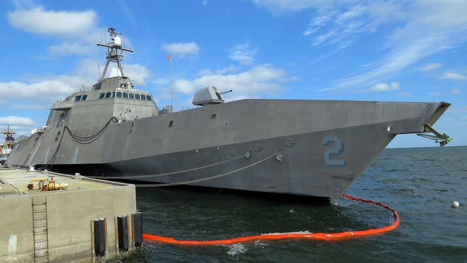 The USS Independence (LCS-2) is the first ship of the Independence variant of littoral combat ship class. The Independence features high speeds, shallow draft and multi mission capabilities that allow it to operate independently or as part of a strike package. The Independence will be testing its mine warfare capabilities docking between sorties in the Gulf of Mexico at Naval Air Station Pensacola. The Independence class is also designed for surface warfare and anti-submarine warfare.