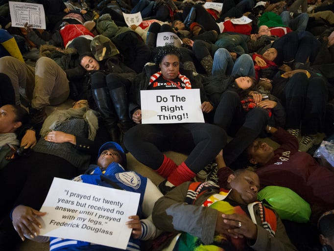 "Protesters participate in a ""die-in"" at Grand Central"