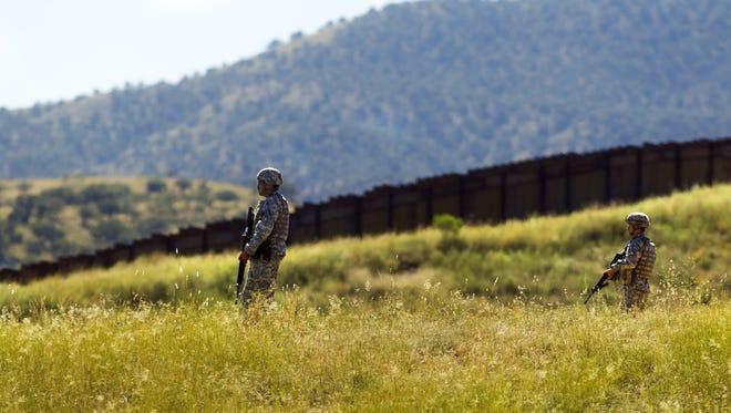 Arizona National Guardsmen monitor the U.S.-Mexico border near Nogales in 2010.