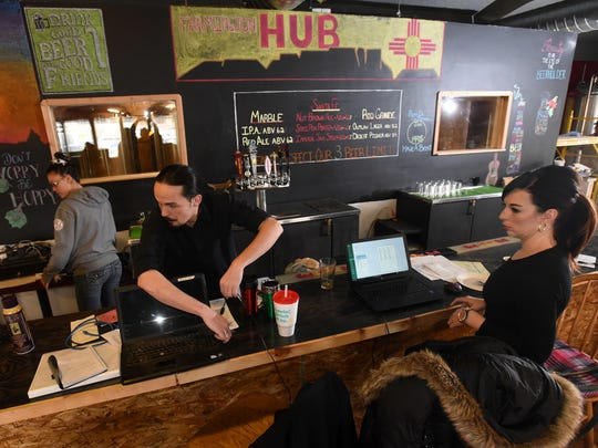 Kimi Newland, left, Seth Harris and Erica Wallace work on Jan. 15 to prepare the Farmington HUB, Brewery and Grill for its opening.