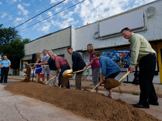 City officials and leaders turn over dirt during a ceremonial groundbreaking for the upcoming Route 66 streetscape and Broadway plaza construction project on Wednesday, Aug. 10, 2016.