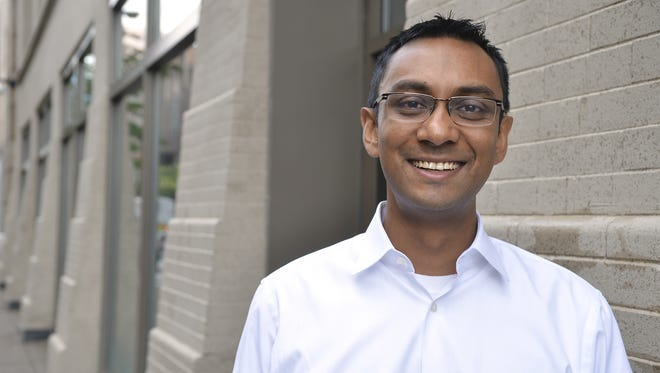 Mynul Khan, CEO of Field Nation, stands outside his Minneapolis office in 2012.