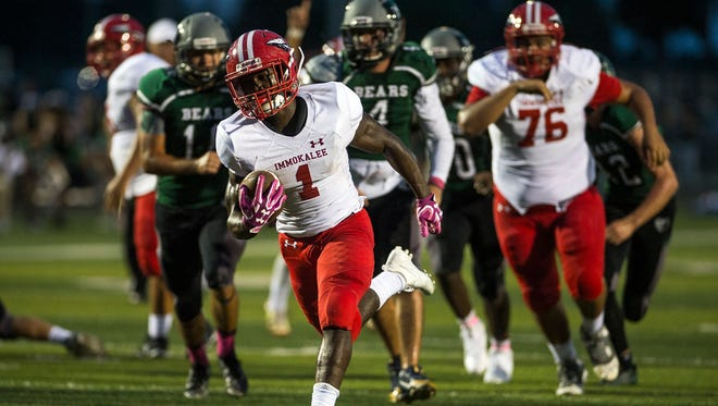 Immokalee High School's Fred Green brings the ball up field during a game against Palmetto Ridge High School on Friday, October 6, 2017.
