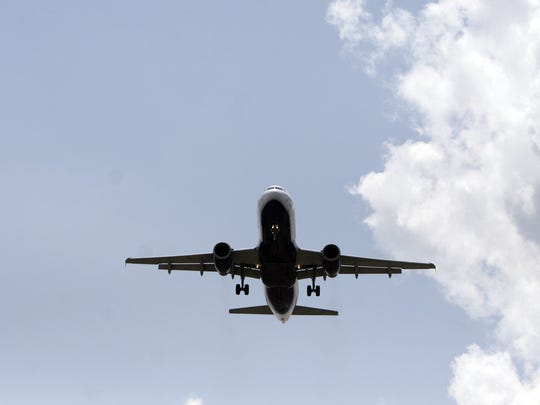 A passenger jet approaches Newark Liberty International Airport for a landing