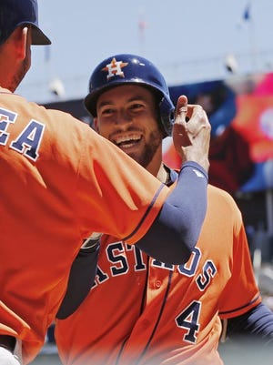 Houston Astros' George Springer, left, celebrates his solo home run off Minnesota Twins pitcher Hector Santiago with Carlos Correa Wednesday as the Astros finished off a sweep in Minneapolis. Houston, leading the AL with a 38-16 record, scored a whopping 40 runs in the three-game sweep.