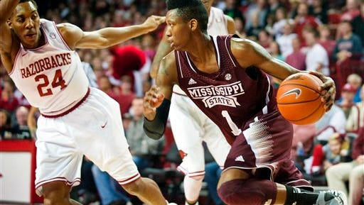 Mississippi State's Fred Thomas (1) looks upcourt after grabbing a rebound as Arkansas' Michael Qualls (24) defends during the first half of an NCAA college basketball game in Fayetteville, Ark., Wednesday, Jan. 23, 2013. Thomas led Mississippi State with 17 points in Arkansas' 96-70 win. (AP Photo/April L. Brown)