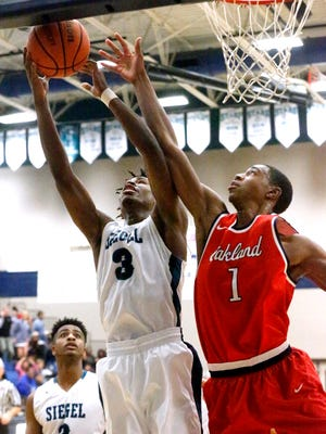 Siegel's Jones Franklin Jr. (3) and Oakland's DD Anderson (1) both go for a rebound Tuesday.
