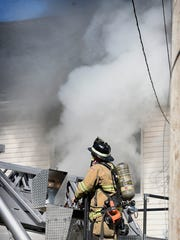 Firefighters were called to the 500 block of Weidman Street shortly after 11 a.m. for reports of smoke coming from a house. The fire heavily damaged a row home at 527 Weidman St. The fire was under control within 20 minutes.