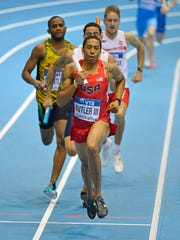 Mar 9, 2014; Sopot, Poland; Kind Butler III runs the third leg on the United States 4 x 400m relay that won in a world record 3:02.13 in the IAAF World Indoor Championships in Athletics at Ergo Arena. Mandatory Credit: Kirby Lee-USA TODAY Sports