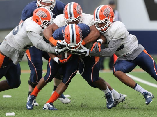 UTEP running back Orion Prescott was swarmed by defenders during Friday's scrimmage.