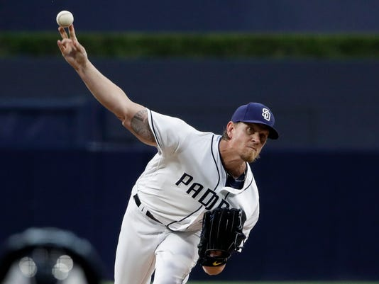 San Diego Padres starting pitcher Jered Weaver throws to a Colorado Rockies batter during the first inning of a baseball game Wednesday, May 3, 2017, in San Diego. (AP Photo/Gregory Bull)