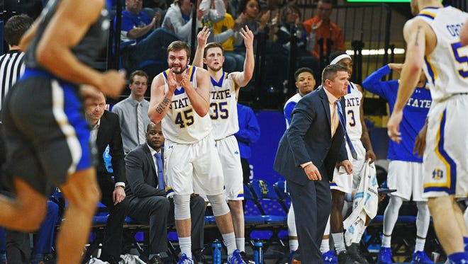 SDSU's Ian Theisen (45) and A.J. Hess (35) react from the bench after a teammate scored during a game against Fort Wayne Saturday, Jan. 21, 2017, at Frost Arena on the South Dakota State University campus in Brookings, S.D.