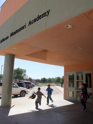 Students run to their parents' cars after school on Friday afternoon.