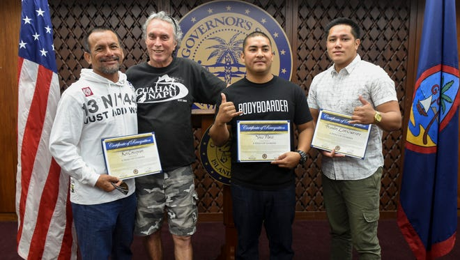 "Guahan Napu President Willie Byerly, second from left, is photographed with local bodyboarders, from left, Ken Concepcion, Vincent Flores and Brandon Leon Guerrero, as they display ""Hero of Guahan"" certificates they were presented during a ceremony at Adelup on Thursday, Jan. 26, 2017. The bodyboarders, and three Guam Fire Department personnel, were recognized for their actions in rescuing six paddlers whose outrigger canoe was overturned by rough seas near the entrance of the Hagåtña boat basin on Jan. 17. Also recognized but not present for the ceremony was civilian, Kawika Naholoowa. Guahan Napu is a local non-profit association of surfers and body-boarders."