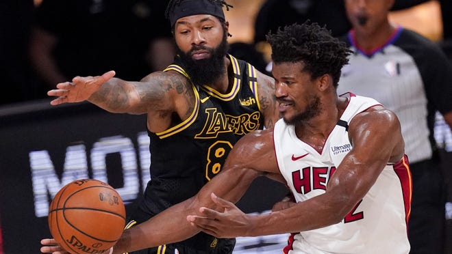 Los Angeles Lakers forward Markieff Morris vies for a rebound with Miami Heat forward Jimmy Butler in Game 5 of the NBA Finals on Friday.