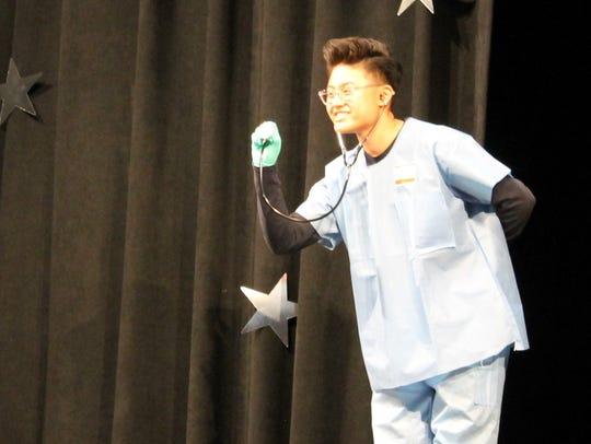 Belleville High School junior Jay Molino performs during