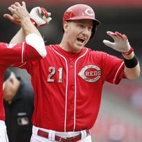 Todd Frazier celebrates at home plate with teammate Joey Votto after his homer.