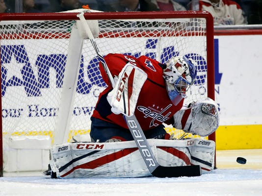 Washington Capitals goaltender Philipp Grubauer, from Germany, deflects a Vancouver Canucks shot during the third period of an NHL hockey game Tuesday, Jan. 9, 2018, in Washington. The Capitals won 3-1. (AP Photo/Alex Brandon)