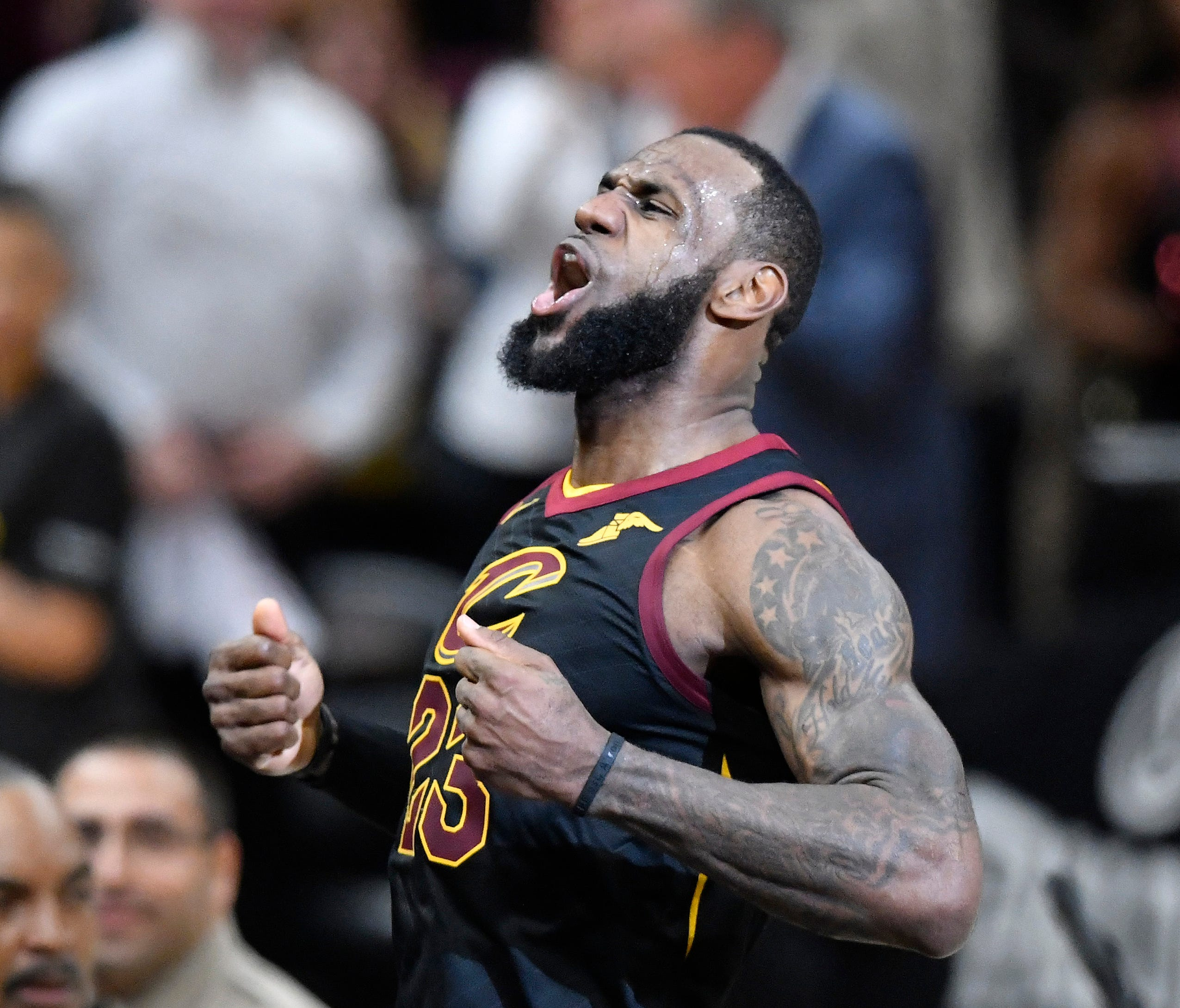 Cleveland Cavaliers forward LeBron James celebrates his game-winning three-point basket in the fourth quarter against the Indiana Pacers.