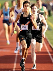 Northville's Nick Couyoumjian (front) set a school