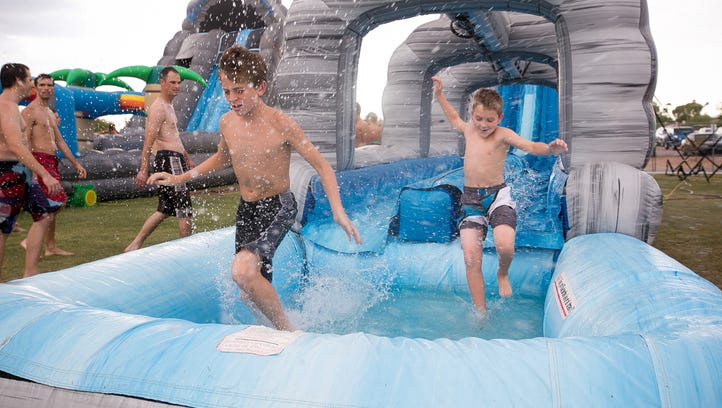 John Vilhauer, left, 13, and Blake Ross, 10, jump into