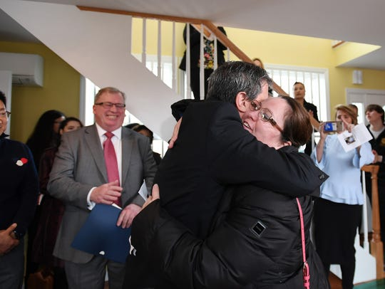 Bergenfield Mayor Norman Schmelz hugs Geovana Pimentel
