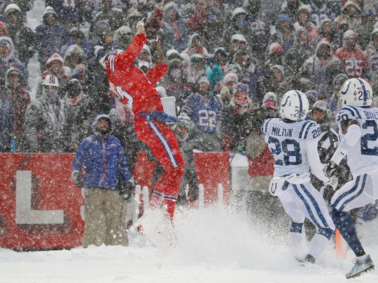 Buffalo Bills' Kelvin Benjamin catches a touchdown during the first half of an NFL football game against the Indianapolis Colts, Sunday, Dec. 10, 2017, in Orchard Park, N.Y. (AP Photo/Jeffrey T. Barnes)