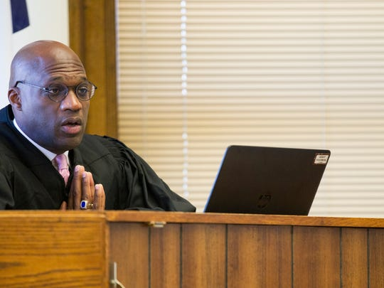 District Judge Kevin McKeever speaks during a competency