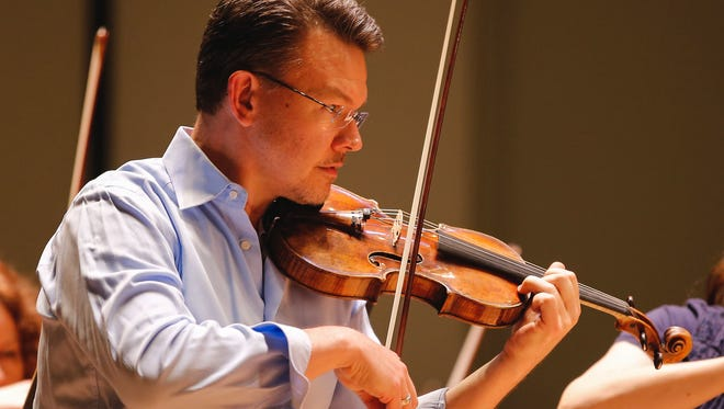 Timothy Lees, pictured at the Taft Theatre, the concertmaster of the Cincinnati Symphony Orchestra, made a brief return following surgery but is now back on medical leave.