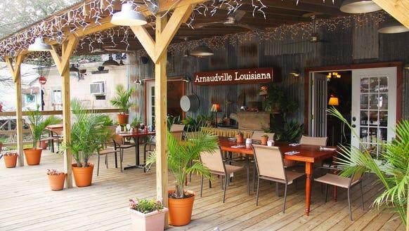 Little Big Cup's deck dining overlooks Bayou Fuselier