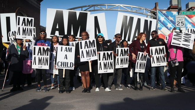 Marchers gather for the I Am A Man march to commemorate the 50th Anniversary of Martin Luther King Jr.'s assassination Wednesday, April 4, 2018, in Memphis, Tenn.