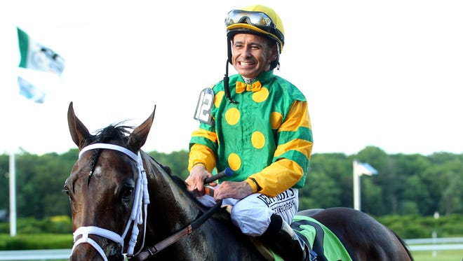 Palace Malice, with jockey Mike Smith up, is walked to the winner's circle by owner Cot Campbell after winning the 145th Belmont Stakes on June 8.
