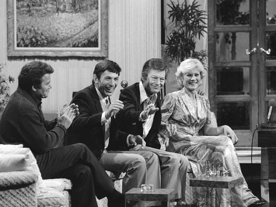 Cast members of Star Trek II: The Wrath of Khan get together for a special salute on The MERV Show in 1982 in Los Angeles. Members of the USS Enterprise, from left, are William Shatner, Leonard Nimoy, DeForest Kelley and Bibi Besch.