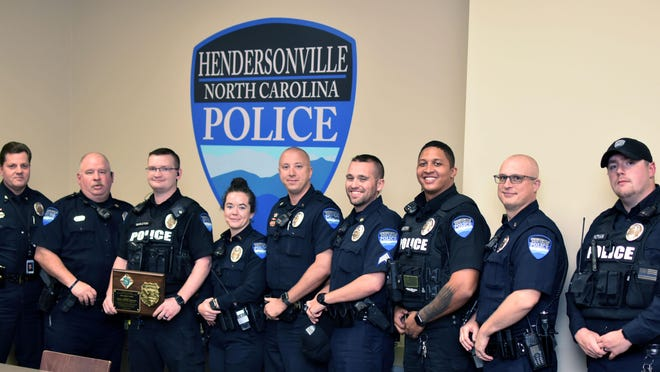 Officer Cameron Singleton with the Hendersonville Police Department was recently honored with a Shield Award. He is pictured here, third from left, with fellow officers.