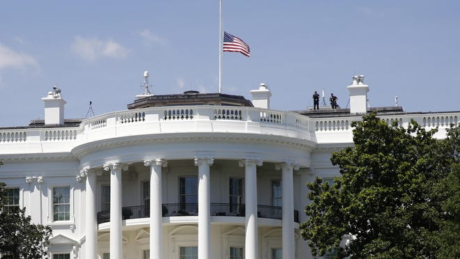 An American flag flies at half-staff over the White House on Saturday in Washington in remembrance of Rep. John Lewis, D-Ga. Lewis, who carried the struggle against racial discrimination from Southern battlegrounds of the 1960s to the halls of Congress, died Friday.