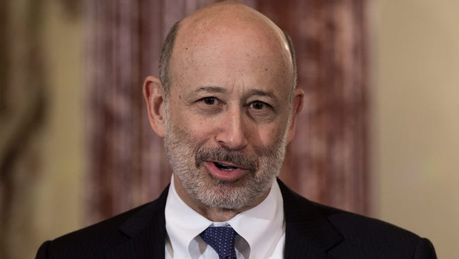 (FILES) In this file photo taken on March 9, 2015, Goldman Sachs chairman and CEO Lloyd Blankfein speaks at the State Department in Washington, DC.    Blankfein is in talks to retire and has been contributing to the bank's choice of a successor, the Wall Street Journal reported on March 9, 2018. Blankfein, 63, one of the most prominent figures on Wall Street, could leave ahead of, or early in 2019 -- Goldman's 150th anniversary -- the newspaper said. A source close to the situation told AFP there was no firm timetable to Blankfein's departure.  / AFP PHOTO / Nicholas KAMMNICHOLAS KAMM/AFP/Getty Images ORIG FILE ID: AFP_1289NF