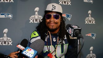 Marshawn Lynch speaks during a Super Bowl XLIX media availability at the Arizona Grand Hotel on Jan. 28, 2015 in Chandler, Ariz.