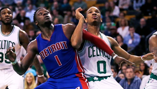 Detroit Pistons guard Reggie Jackson (1) and Boston Celtics guard Avery Bradley (0) lock arms on a rebound during the second half of an NBA basketball game in Boston, Wednesday, Feb. 3, 2016.