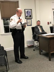 East Hampton Police Chief Dennis Woessner says an officer's membership in the Proud Boys far-right group didn't violate department policies.