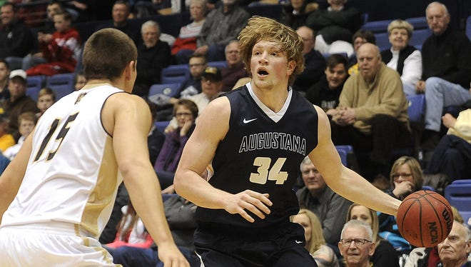 Augustana's #34 Daniel Jansen looks for an open teammate against SMSU's #15 Joey Bartlett during basketball action at the Arena in Sioux Falls, S.D., Sunday, Jan. 3, 2016.