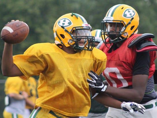 Harrison's senior quarterback Noah Hendricks (left)