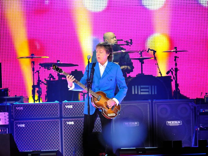 Sir Paul McCartney is seen performing with his band during the ?Out There Tour at the Times Union Center on July 5, 2014, in Albany.