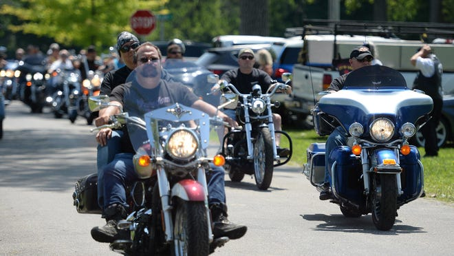 Bikers arrive Saturday at Gravel Pit Park in North East Township for a Back the Blue police support rally organized by Erie County Councilman Brian Shank.