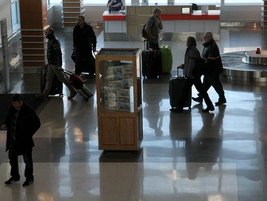 The new baggage claim area is busy after a plane coming