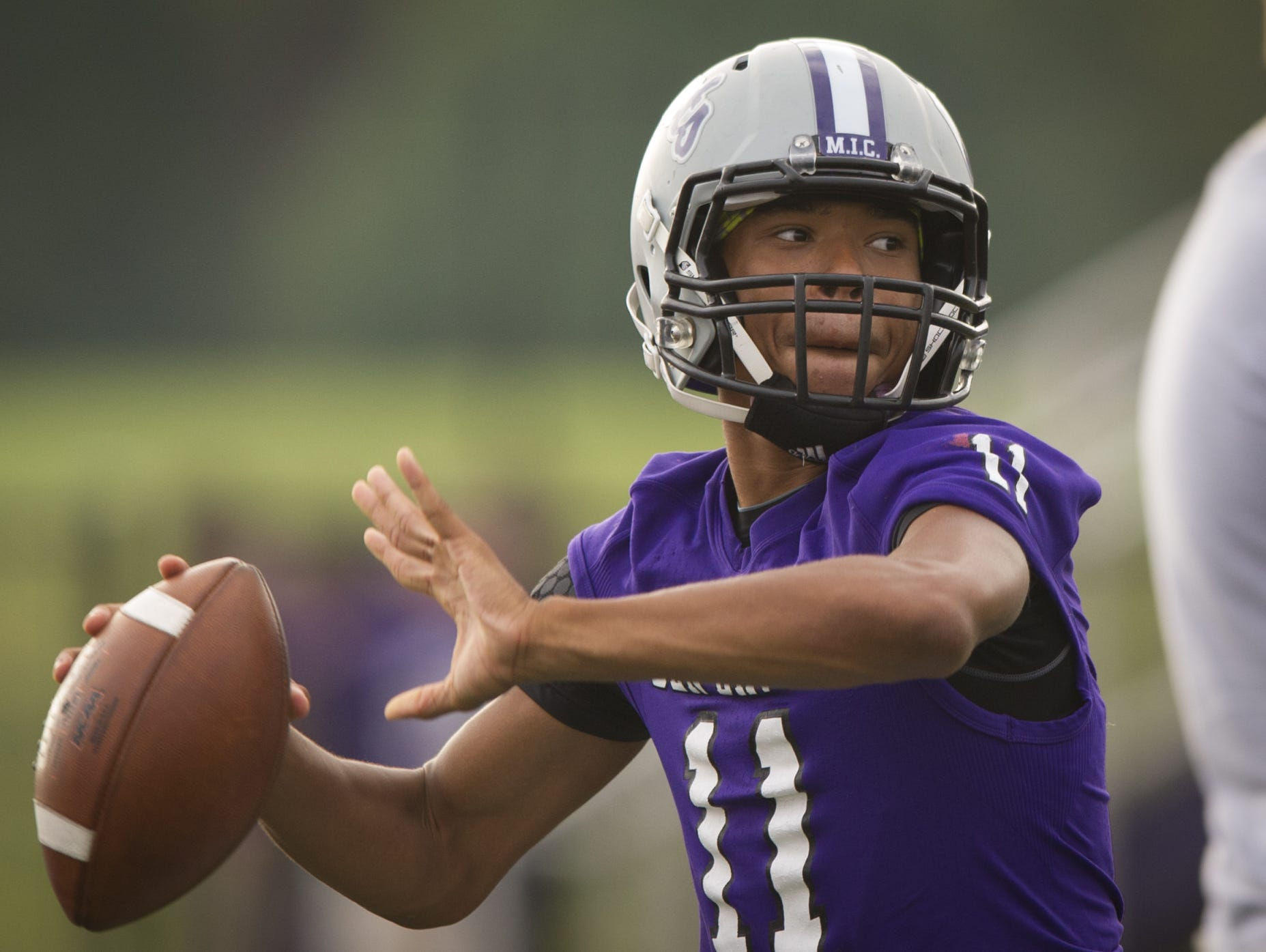 Ben Davis High School sophomore Reese Taylor (11) warms up his arm during pre-game activities of a IHSAA varsity football game at Ben Davis High School, Friday, September 18, 2015.