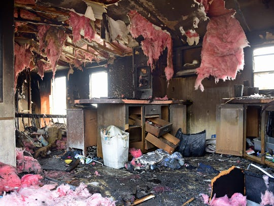 Fire damage is seen int the interior of  a mobile home